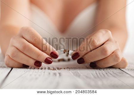 Woman Breake Down Cigarette. Winning With Addicted Nicotine Problems, Stop Smoking. Quitting From Ad