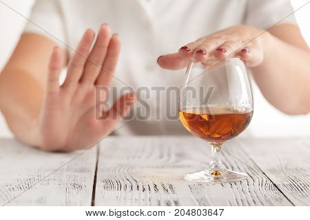 woman hand refuses to drink a alcohol