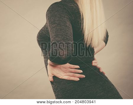 Woman Holding Her Back Feeling Pain