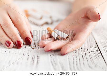Woman With Broken Cigarette. Stop Smoking Concept.