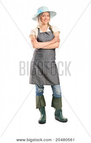 Full length portrait of a female manual worker posing isolated on white background