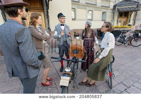 KYIV, UKRAINE - SEP 17, 2017: Group of old-fashioned style people in vintage clothing talking at the cycling festival Retro Cruise on June 17, 2017. Kiev is the 8th most populous city in Europe