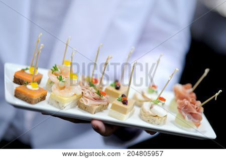 close up tray of appetizers in wedding party