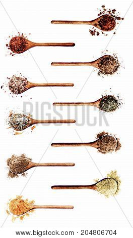 Collection of Various Spices in Wooden Spoons: Dried Paprika Dried Chili Salt with Chili Salt with Cayenne Pepper Coriander Salt with Petals Cumin Powder Thyme Zira and Curry Powder on White background