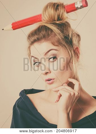 Thinking Blonde Woman Having Big Pencil In Hair