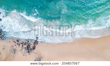 Sea Aerial view Top viewamazing nature background.The color of the water and beautifully bright.Azure beach with rocky mountains and clear water of Thailand ocean at sunny day.flying dronesea view