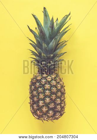 Pineapple on yellow bright background. Summer concept matte effect