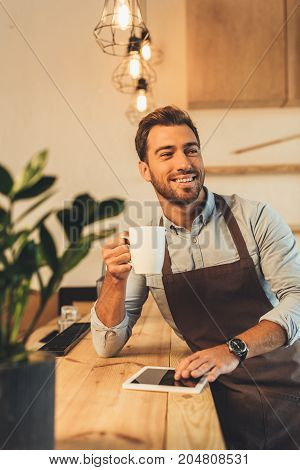 Barista With Cup Of Coffee