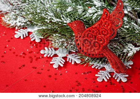 Christmas toys and spruce branches on red background top view.