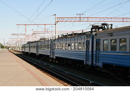 old blue train on the railway tracks