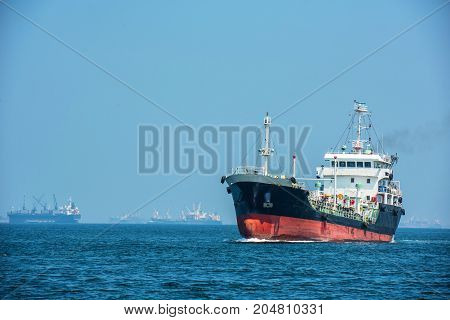 oil tanker gas tanker in the high sea.Refinery Industry cargo shipaerial viewThailand in import export LPGoil refinery Logistics and transportation with working crane bridge in harbor
