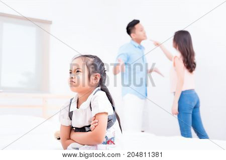 Frustrated of little girl is disaster in argument of mother and father in family conflict