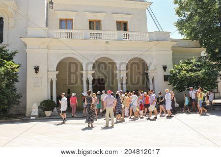 Yalta, Crimea - 11 July, Visitors at the entrance to the palace, 11 July, 2017. Architecture of the Levada Palace in Yalta.