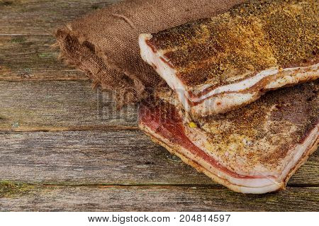 Salted Pig Fat With Spices. Bacon, Spices On A Wooden Board.