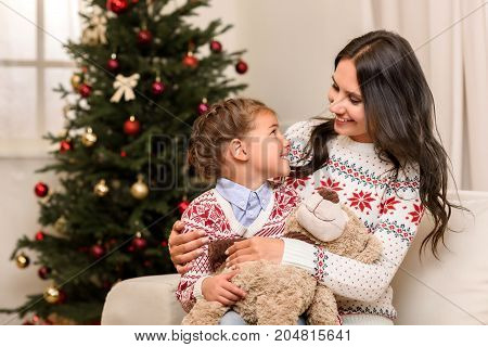 Mother And Daughter With Teddy Bear