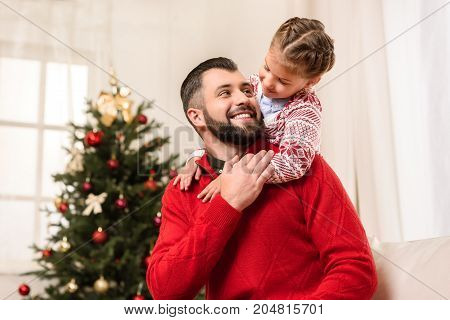 Happy Father And Daughter At Christmas