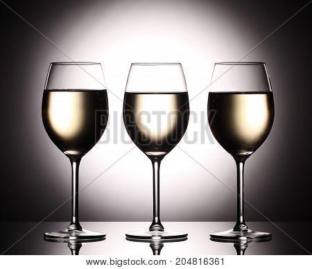 Wineglasses With White Wine - Transperent Liquid - On Studio Background.