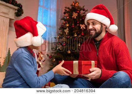 Father And Son With Christmas Present