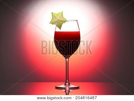 Wineglass Red Liquid Cocktail Decorated With Green Carambola In Studio Pink Background.