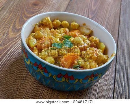 Vegetable tarkari - spicy vegetable curry which is very popular in Bangladesh India Pakistan and Nepal.