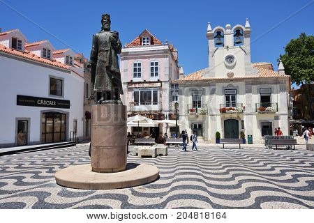 CASCAIS PORTUGAL - JUNE 8 2017: Central square 5th October in Cascais with statue of Dom Pedro I. Cascais is famous and popular summer vacation spot for Portuguese and foreign tourists