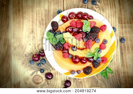Fresh fruit salad made with organic fruits - healthy food, vegetarian eating, healthy eating