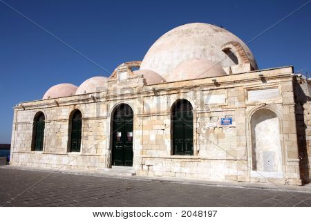 The Janissaries' Mosque beside the harbour in Hania's old town built in 1645 it is the oldest surviving Ottoman building in Crete. poster