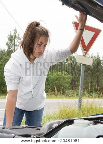 Girl Brunette Woman With A Broken Car With Open Hood