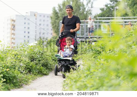 Warsaw, Poland - August 2, 2017: Dad And His Son Spend Time In The City Park.