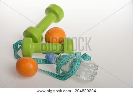 Sports And Healthy Regime, Copy Space. Barbells Near Juicy Oranges