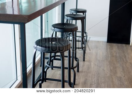Stool In Front Of Counter Bar At Coffee Shop