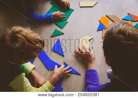 teacher and kids playing with geometric shapes, kids learning