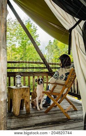 A woman and her dog glamping in New York.