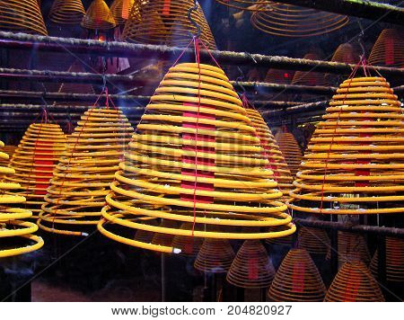 Huge incense sticks in a Buddhist temple