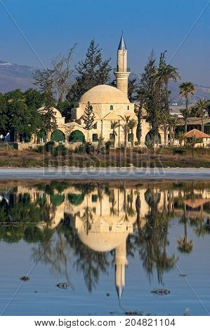 View of the Mosque of Umm Haram or Hala Sultan Tekke on the west bank of Larnaca Salt Lake, near Larnaca, Cyprus