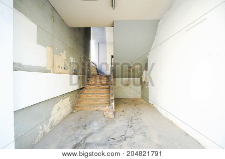Deserted room and staircase in ancient building