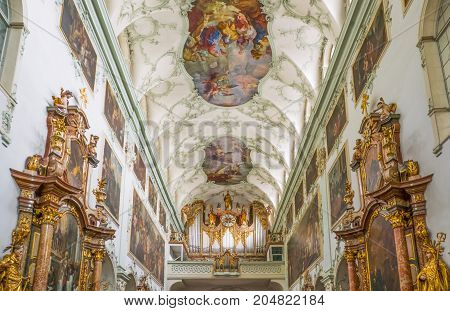 Salzburg Austria - August 4 2016: The ancient organ in the nave of the St Peter Abbey Church