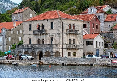 MONTENEGRO, PERAST - AUGUST 13, 2017: View of the Palace of Buyoviches on the waterfront in Perast built in the 17th century architect Giovanni Battista Fontana landmark