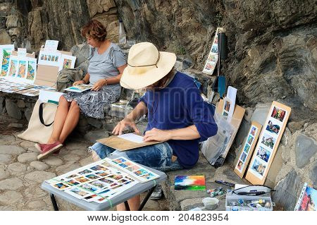 Manarola Riomaggiore (SP) Italy - September 15 2017: Street painters sell their paintings on the streets of the city. Manarola is a small town in the province of La Spezia in Liguria northern Italy.