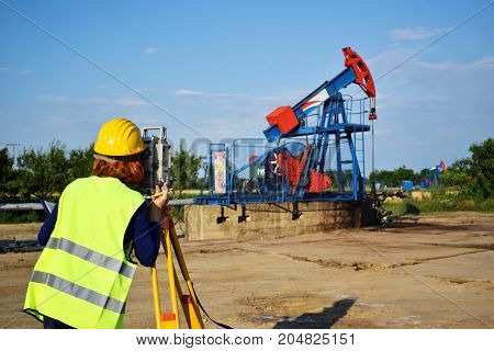 A woman land surveyor engineer at work on an east European oil field