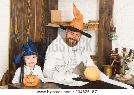 Man And Boy On Wood And White Brick Background