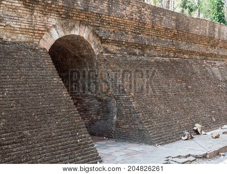 Entrance of the stone brick tunnel to the internal church of the forest monasteryThailand.