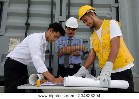 Engineer Team Writing Construction Plan On Paper