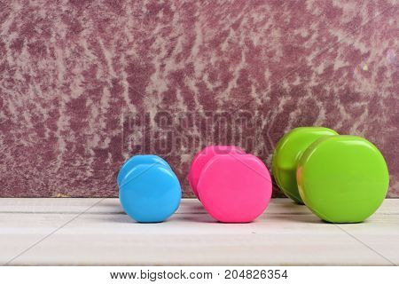 Healthy Shape Concept. Barbells In Green, Pink And Cyan Color