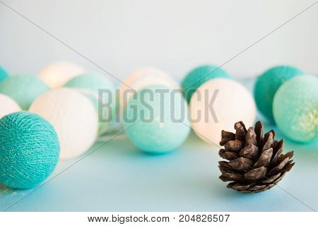 Cone On The Blue Background With Blue And White Lights Made Of Yarn Threads, Closeup. Christmas Deco