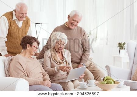 Elder Friends Are Using Laptop