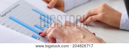 Two Businesswomen Hold In Hands Graph