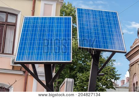 Environmentally friendly photovoltaic solar panels on a background of clean sky