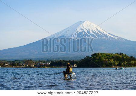 Japanese Man Fishing At Lake Kawaguchiko