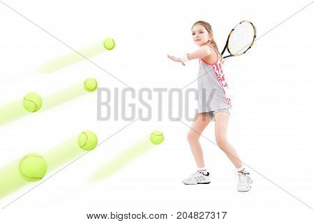 Young pretty girl tennis player beats flying balls, isolated on a white background